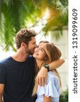young guy kissing girlfriend ... | Shutterstock . vector #1319099609