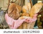 wicker basket full of bread. | Shutterstock . vector #1319129033