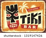 tiki bar vintage tin sign with... | Shutterstock .eps vector #1319147426