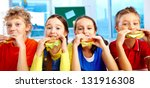 four schoolkids looking at... | Shutterstock . vector #131916308