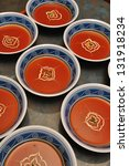 busy cooks garnish bowls of...   Shutterstock . vector #131918234
