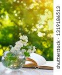 jasmine flowers in glass vase... | Shutterstock . vector #1319186513