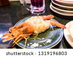 fresh sushi platter served in... | Shutterstock . vector #1319196803