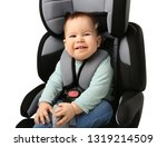 baby boy buckled in car seat on ... | Shutterstock . vector #1319214509