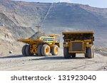 giant ore trucks  in open pit... | Shutterstock . vector #131923040