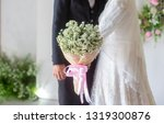 lovely bride holding a bouquet... | Shutterstock . vector #1319300876