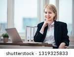 young woman working in office | Shutterstock . vector #1319325833