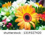 bouquet of white and orange... | Shutterstock . vector #1319327420