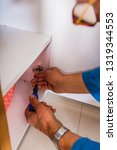 handyman is in the kitchen and... | Shutterstock . vector #1319344553