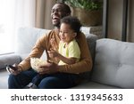 happy african american dad and... | Shutterstock . vector #1319345633