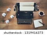 vintage typewriter on rustic...   Shutterstock . vector #1319416373