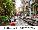 Popular place and one of the main attraction of Hanoi, Vietnam City. Train passing through the narrow street between old many houses in Hanoi. Way of life of people in Hanoi, Vietnam City, Blur Image.