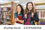 mixed race female students... | Shutterstock . vector #1319468306