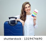 happy woman travel holding... | Shutterstock . vector #1319474690