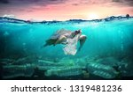 Stock photo plastic pollution in ocean turtle eat plastic bag environmental problem 1319481236