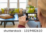 woman taking pictures of a... | Shutterstock . vector #1319482610