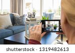 woman taking pictures of a... | Shutterstock . vector #1319482613
