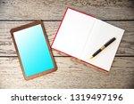 a modern digital tablet with a... | Shutterstock . vector #1319497196