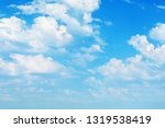 white clouds in the blue sky in ... | Shutterstock . vector #1319538419