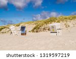 beach chairs on the island of... | Shutterstock . vector #1319597219