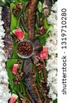 Small photo of Boodle Fight consisting of grilled catfish with fruits, rice and vegetables on banana plant leaves