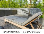 wooden daybeds on terrace by...   Shutterstock . vector #1319719139