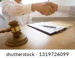 lawyer handshake. lawyer people ... | Shutterstock . vector #1319726099
