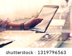 stock trading graphs and hands... | Shutterstock . vector #1319796563