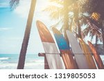 many surfboards beside coconut... | Shutterstock . vector #1319805053