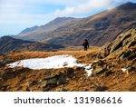 hiker on a high mountain field  ... | Shutterstock . vector #131986616