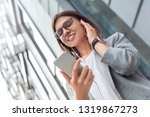 young businesswoman wearing... | Shutterstock . vector #1319867273