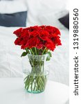 A Bouquet Of Red Roses In A...