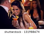 happy couple at the bar... | Shutterstock . vector #131988674