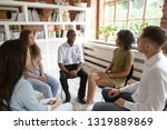 african man speaking at group... | Shutterstock . vector #1319889869