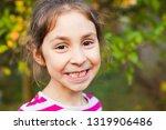 little girl smiling showing her ... | Shutterstock . vector #1319906486
