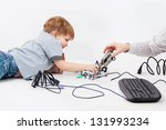 son play with car and keyboard... | Shutterstock . vector #131993234