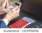man holding debit card in hand... | Shutterstock . vector #1319956946