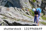 Small photo of rock climbers traverse and climb the Clocher de Planpraz climbing route in the French Alps above Chamonix