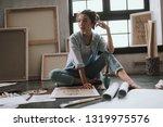 calm young female artist... | Shutterstock . vector #1319975576