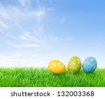 Colorful Easter Eggs On Meadow...