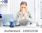 Young Business Woman Sneezing...