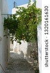 greece island alley | Shutterstock . vector #1320161630