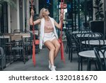 young blonde in a white vest... | Shutterstock . vector #1320181670