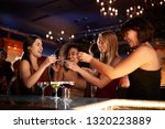 group of female friends... | Shutterstock . vector #1320223889