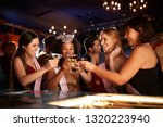 group of female friends... | Shutterstock . vector #1320223940
