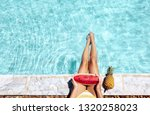 girl sitting by pool and eating ... | Shutterstock . vector #1320258023