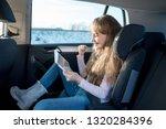 cute little girl sitting in... | Shutterstock . vector #1320284396