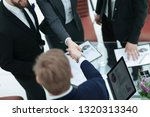 close up. handshake of trading... | Shutterstock . vector #1320313340