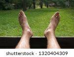 Barefoot Man Enjoying A Green...