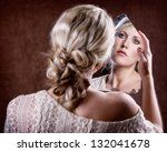 woman looking into a broken... | Shutterstock . vector #132041678